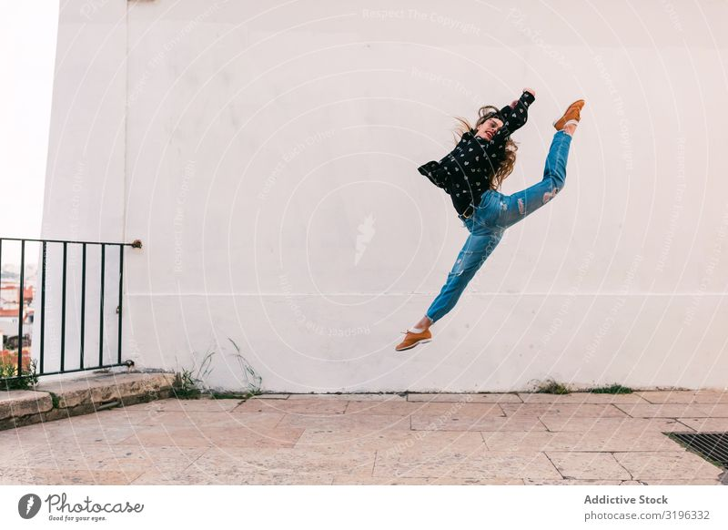 Teen dancer jumping against white wall Woman Jump Dance Splits Fly Freedom Skyline Street grace Recklessness Inspiration Youth (Young adults) pose Action skill