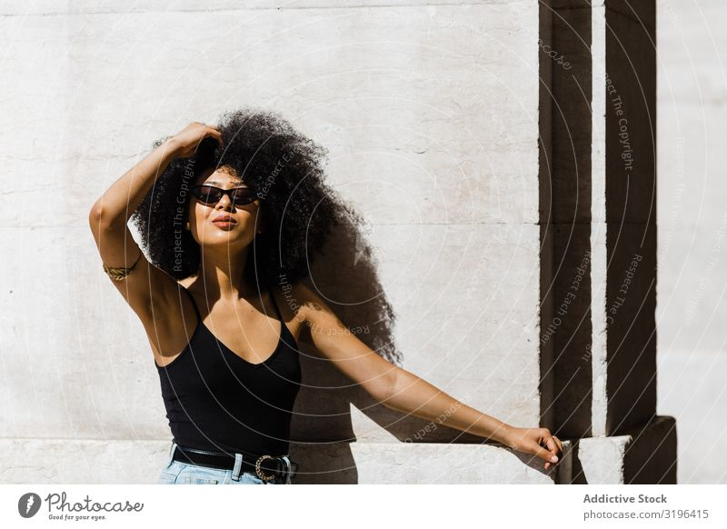 Cheerful African American female in dark sunglasses Woman Style Hip & trendy fashionable Sunglasses Hair and hairstyles Afro Leisure and hobbies