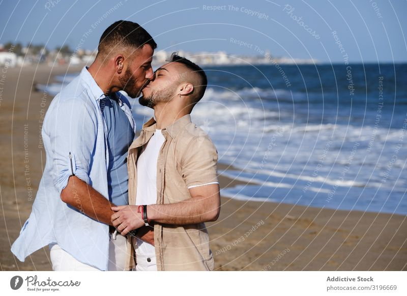 Gay couple kissing on beach Couple Homosexual holding hand Kissing Passion Affection homo Together Relationship lgbt dating Love Youth (Young adults) Ethnic Man