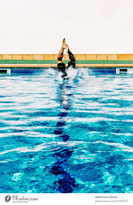 a man enters the pool in a sunny day Diver Blue Human being Youth (Young adults) Water Sports Swimming pool Exterior shot 1 Summer Athlete Vantage point