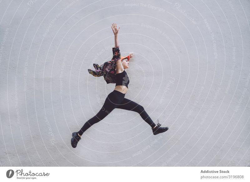 Woman jumping high along wall Jump Expression Attractive Hip & trendy Style Fashion Model