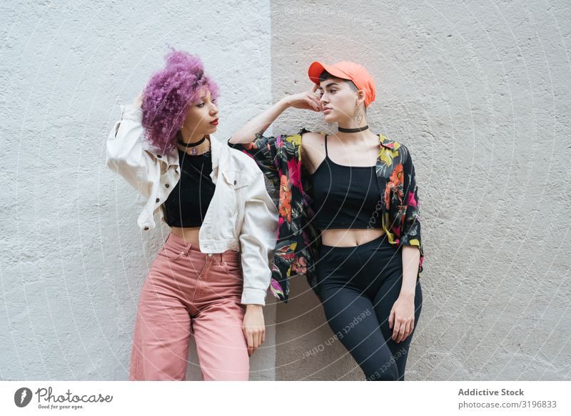 Women leaning and looking at each other Woman Attractive Posture Pink Lean Wall (building) Style Hair and hairstyles Fashion Model Youth (Young adults)