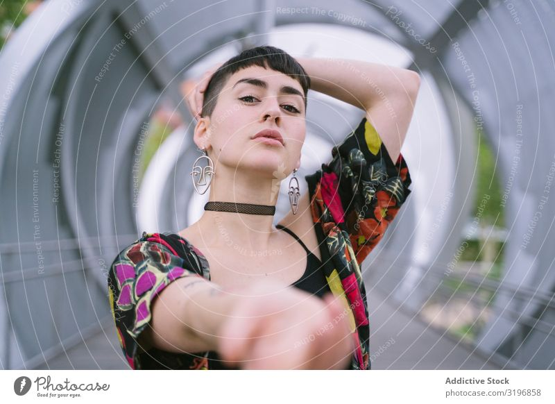 Woman in colorful shirt posing Looking into the camera Portrait photograph Attractive Trust Posture Hip & trendy Style