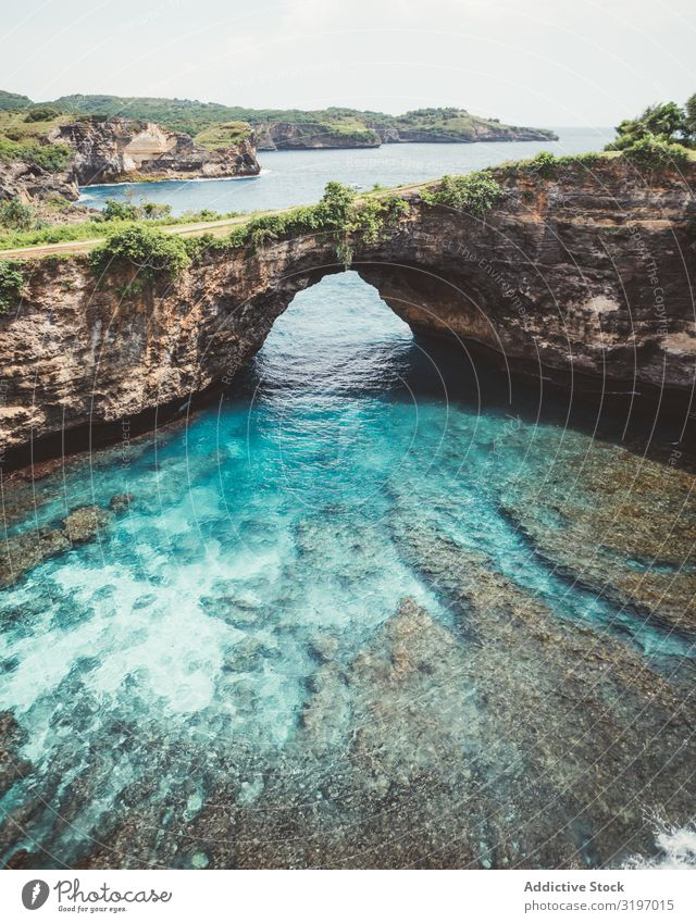 Amazing blue lagoon with cliff archway Lagoon Cliff Arch Landscape Blue Turquoise Bali Formation Tropical Natural Vacation & Travel Nature Water seaside Bay
