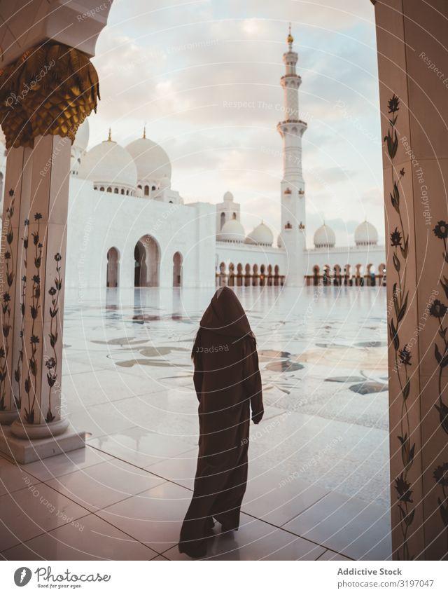 Anonymous muslim woman on square of beautiful mosque Woman Moslem Mosque Dubai Prayer Morning Religion and faith Spiritual