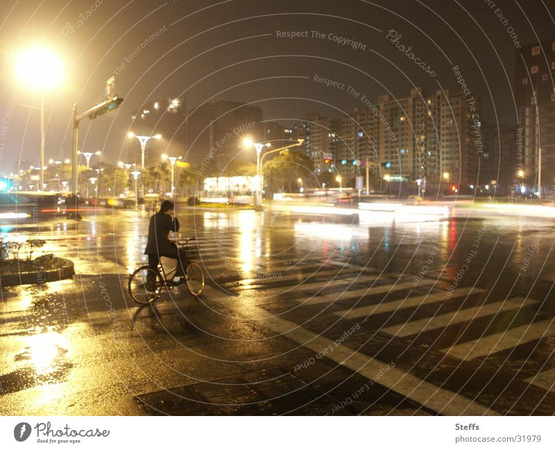 Chinese street in the rain China Bicycle Night Light Transport Reflection Zebra crossing Yellow Gray Man Crossroads Loneliness Dark Evening Moody