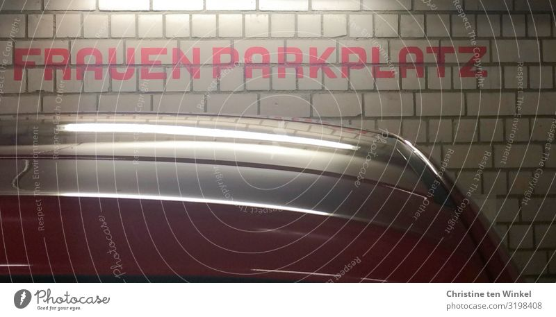 """The word """"women's parking space"""" on a wall in a parking garage Parking garage Wall (barrier) Wall (building) Car Characters Signs and labeling Authentic"""
