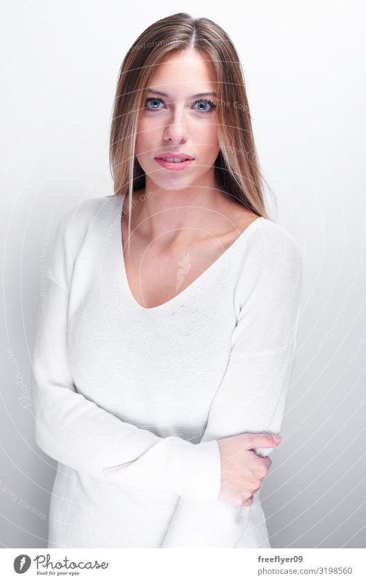Shy woman looking at camera on a white background Joy Happy Beautiful Face Human being Young woman Youth (Young adults) Woman Adults 1 18 - 30 years Sweater