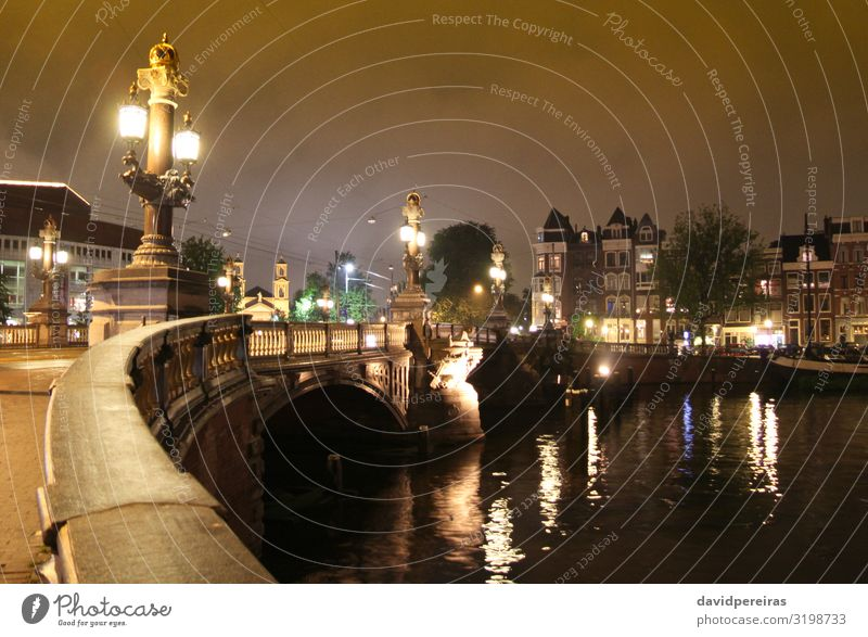 Bridge over the Amstel river at night in Amsterdam Vacation & Travel Tourism House (Residential Structure) River Town Building Architecture Street Old Yellow