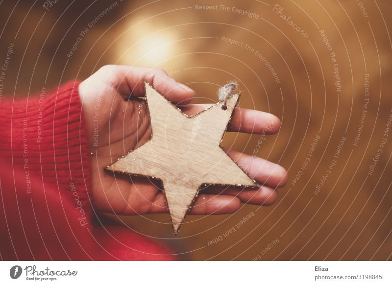 A person holding a wooden star in his hand; Christmas, Advent Christmas & Advent Christmas tree decorations Feminine Christmas decoration by hand Authentic