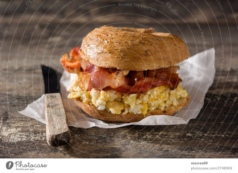 Bagel sandwich with slab bacon, egg and cheese Sandwich Bacon Egg Cheese Bread Snack Fast food Delicious Food Healthy Eating Food photograph Lunch Sesame Dough