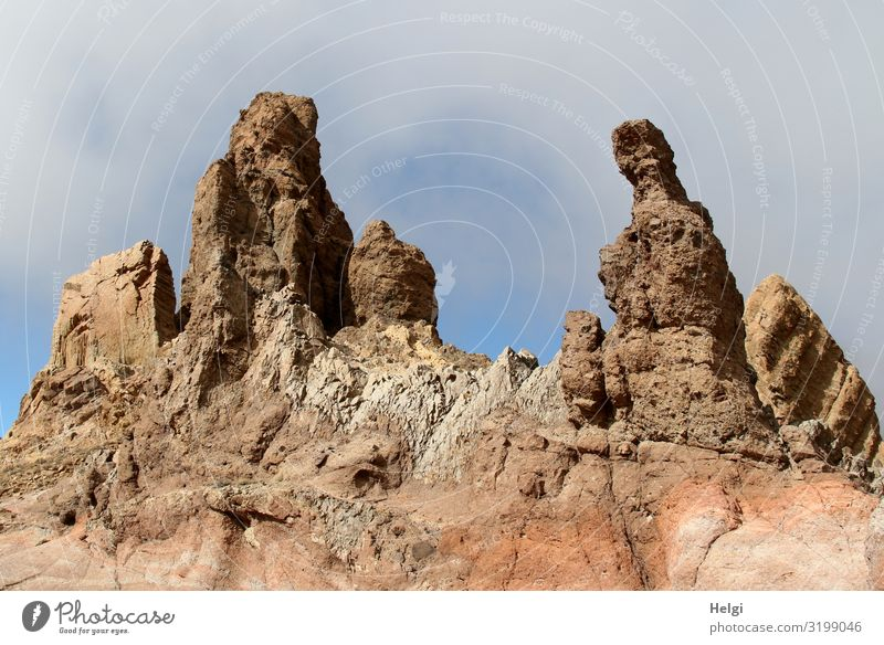 bizarre rock formations in sunshine and cloudy skies in Teide National Park on Tenerife Vacation & Travel Tourism Environment Nature Landscape Sky