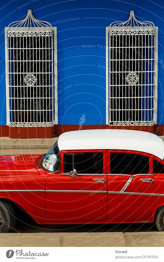 red car parked in front of blue wall , sancti spiritus - cuba Lifestyle Vacation & Travel Tourism Trip Island House (Residential Structure) Decoration Art