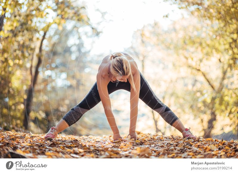 Young woman stretching after workout in the park Healthy Athletic Fitness Wellness Life Sports Sports Training Track and Field Sportsperson Jogging Feminine
