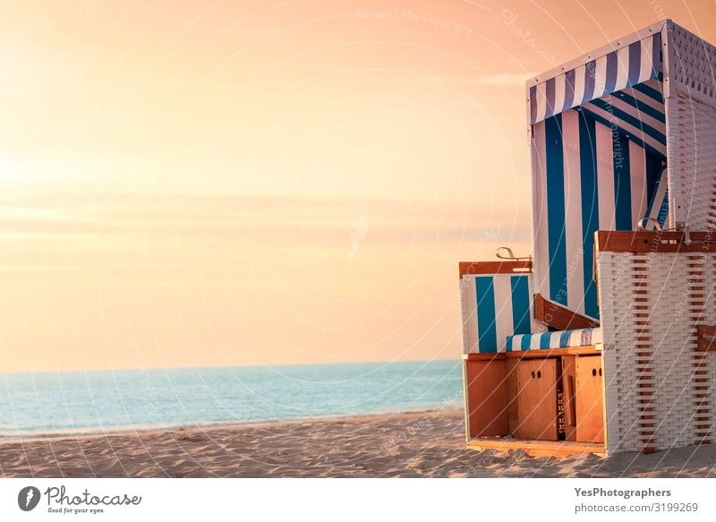 Beach chair and beach at sunset on Sylt. Summer vacation context Harmonious Well-being Relaxation Vacation & Travel Sun Sunbathing Ocean Island Chair Nature