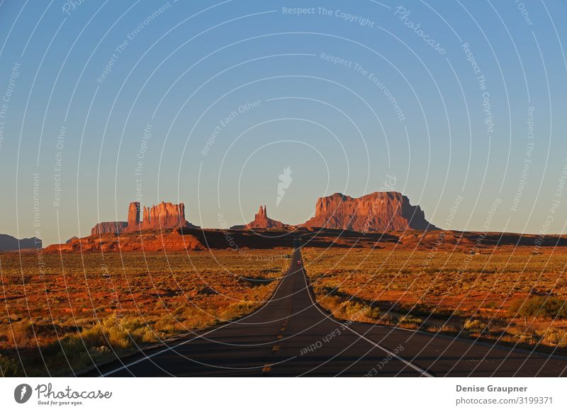 Monument Valley at Sunset in Utah Vacation & Travel Environment Nature Landscape Sand Climate Climate change Weather Beautiful weather Park Mountain Canyon USA