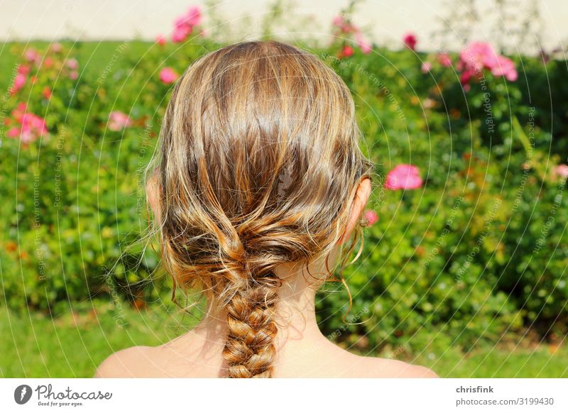 Girl with braided hair in front of Rosenbusch Human being Feminine Child Youth (Young adults) Head Hair and hairstyles 1 8 - 13 years Infancy Braids Angel