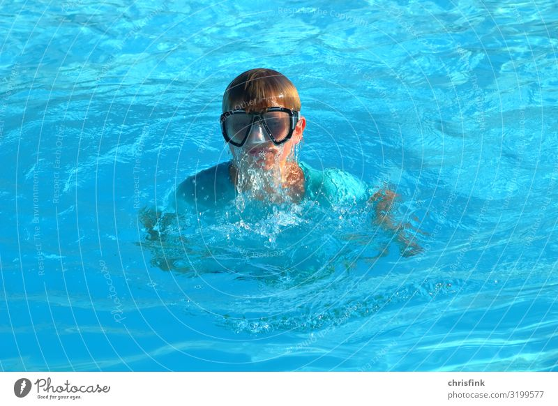 Boy with diving goggles in swimming pool Lifestyle Leisure and hobbies Vacation & Travel Tourism Sports Swimming & Bathing Dive Parenting Boy (child)
