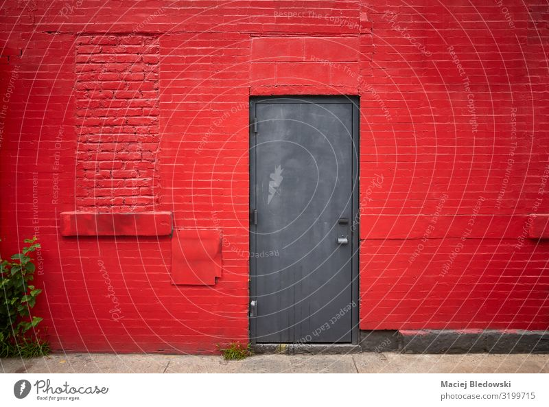 Steel door in an old red brick wall Living or residing House building House (Residential Structure) Building Architecture Wall (barrier) Wall (building) Facade