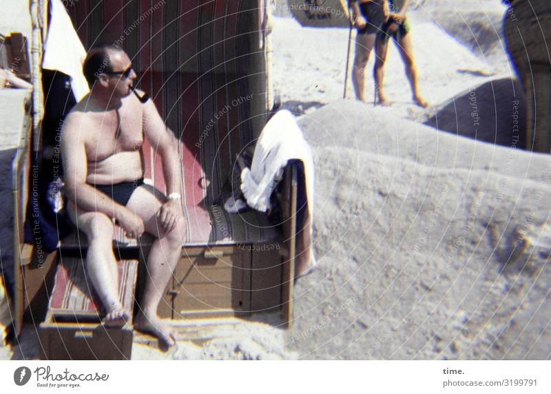 lord of a castle Masculine Man Adults 1 Human being Beautiful weather Coast Beach Swimming trunks Sunglasses Pipe Observe Smoking Looking Sit Hot Bright
