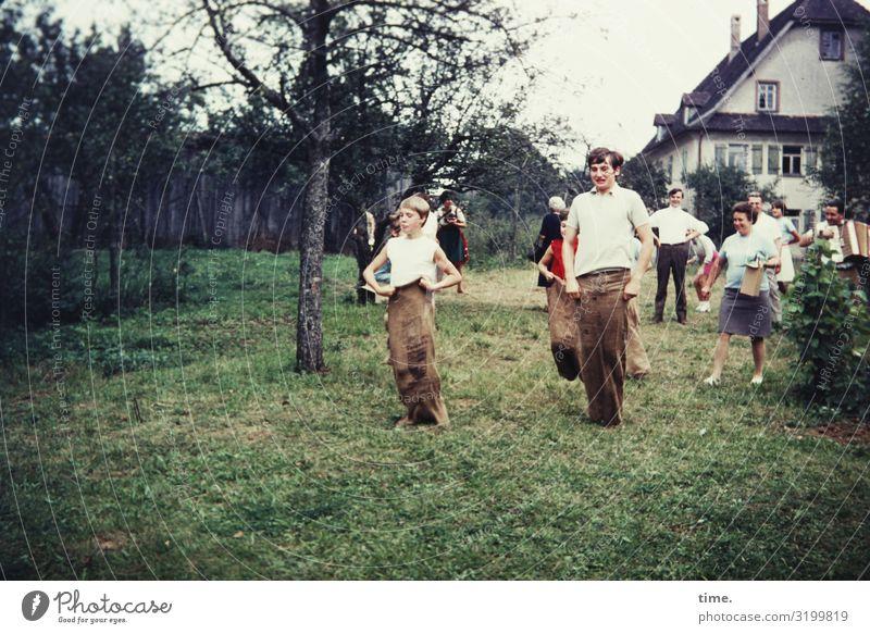 Childhood games. Sack's gotta bounce. Living or residing Flat (apartment) Garden Feasts & Celebrations Sports Girl Boy (child) Woman Adults Man