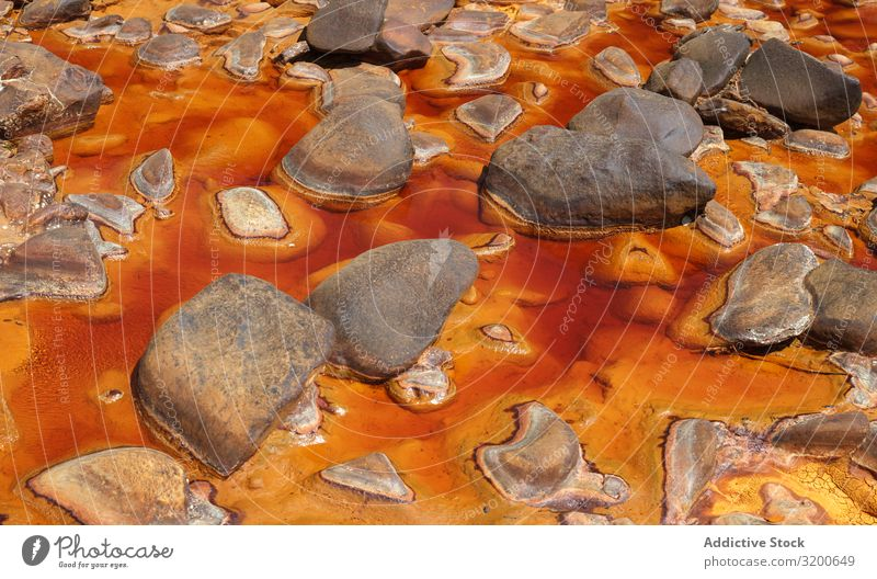 Bright orange splashes in nature Transition Background picture Mountain Abstract Rock geological Orange Stream Stone Yellow Beautiful Natural scenery