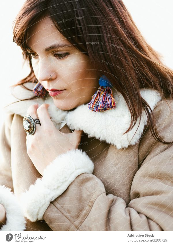 Portrait of thoughtful model with handmade earrings Portrait photograph Model Earring Self-made Considerate Woman Beautiful Brunette Thread Hip & trendy