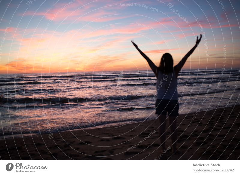Female tourist posing on seaside at sunset Tourist Sunset Woman Posture Gesture Heart Beach Sand Picturesque Sky Walking Vacation & Travel Lifestyle
