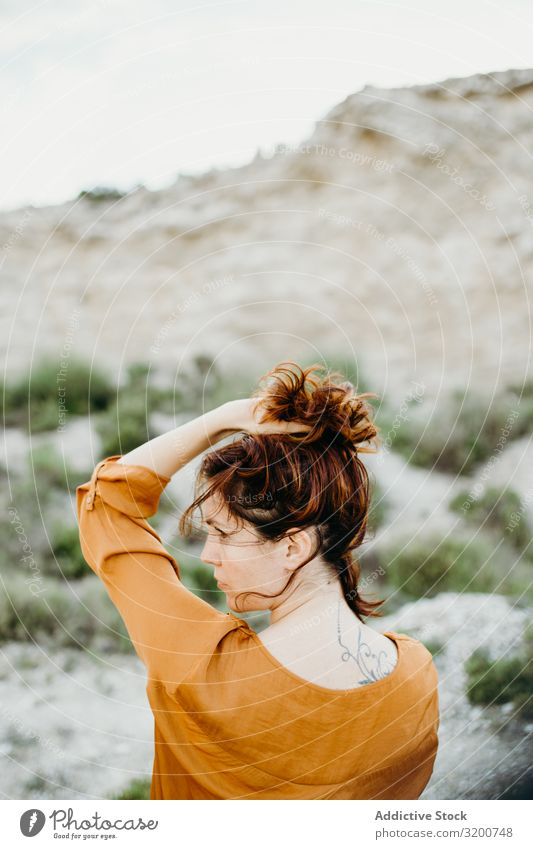 Dreamy attractive young woman posing outdoors Woman Posture Attractive Youth (Young adults) Model Portrait photograph Considerate Blouse Hand Wild Desert