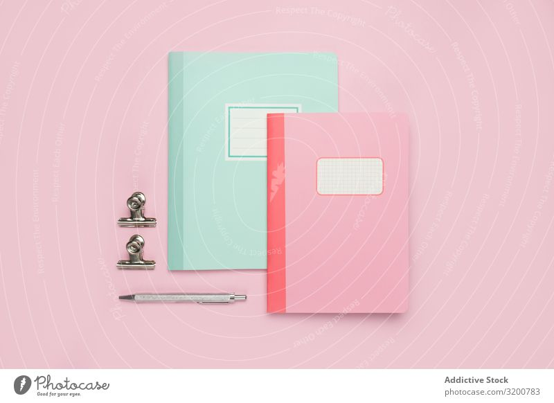 School stationery set on pink background Stationery Notebook Pen Ruler Pencil Office Accessory