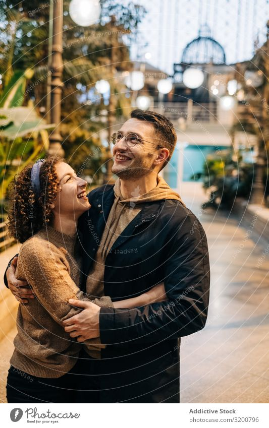 Happy couple hugging in pavilion Couple Embrace Date Pavilion looking at each other Youth (Young adults) City Love romantic Man Woman Together girlfriend