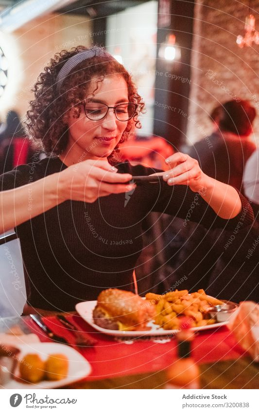 Young woman taking photo of food Woman Food Photography PDA Café French fries Lifestyle Leisure and hobbies