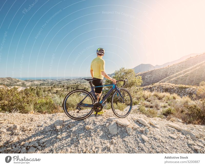 man resting and enjoying the views while riding a bicycle on a mountain road Leisure and hobbies Athlete Sports Ride Bicycle Racing sports Man Motorcycling