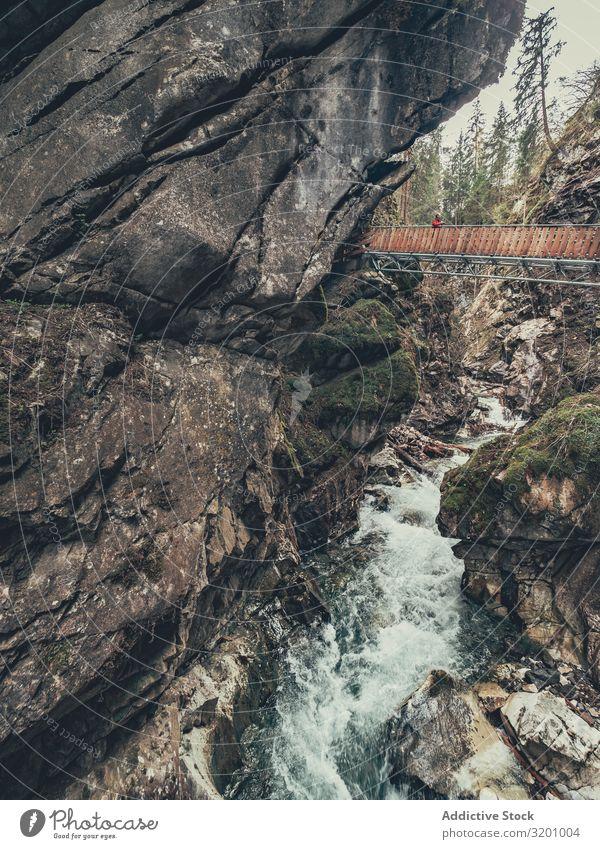 Bridge of tourist path among beautiful mountains Tourist Lanes & trails Mountain Beautiful hiker enjoying Vantage point Majestic Landscape Picturesque Alps