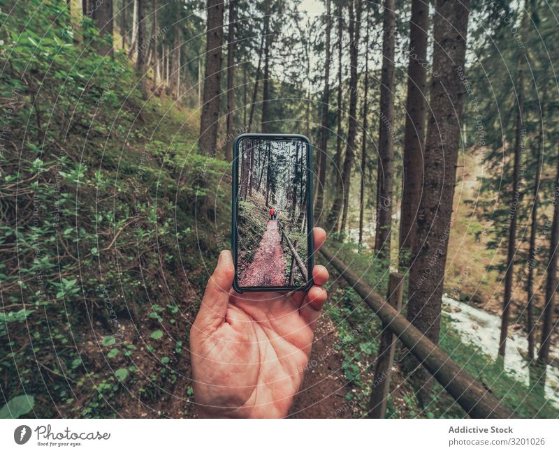 Tourist taking photo while walking on footpath hiker Friendship Walking Footpath traveller Hiking Picturesque Area Alps Dolomites Italy Lifestyle PDA Technology