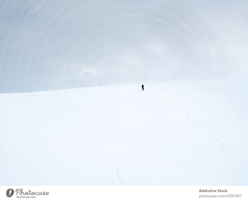 Unrecognizable lonely traveler walking on snowy hill Loneliness Inspiration Snow Minimalistic Hill Landscape Nature Mountain Tourism Adventure Cold Tourist