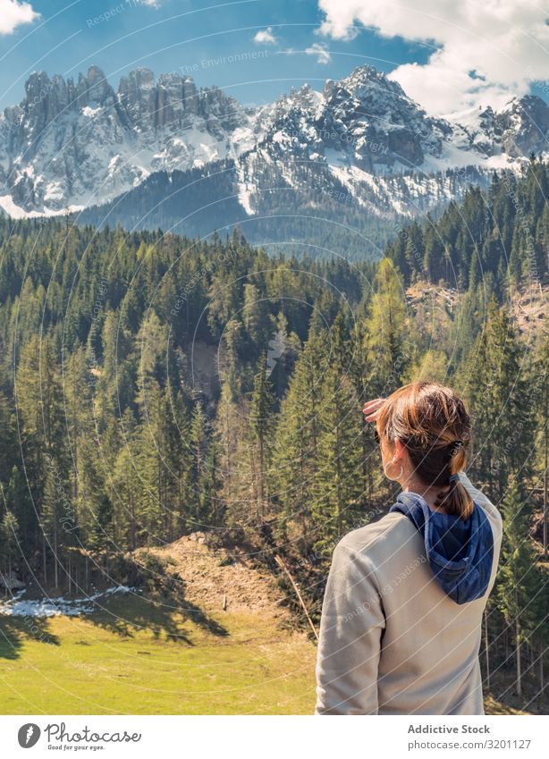 Woman covering face from sun and looking at amazing landscape Mountain Majestic Landscape Nature Vacation & Travel Sky Adventure Water Cold Beautiful Sports