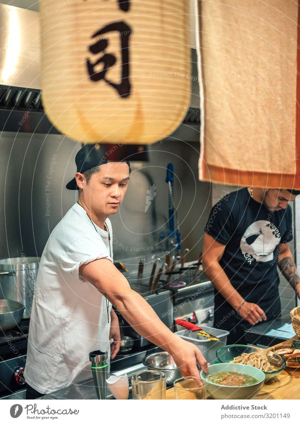 Young males working in kitchen Man Cooking Food Japanese Dish Restaurant Kitchen Work and employment