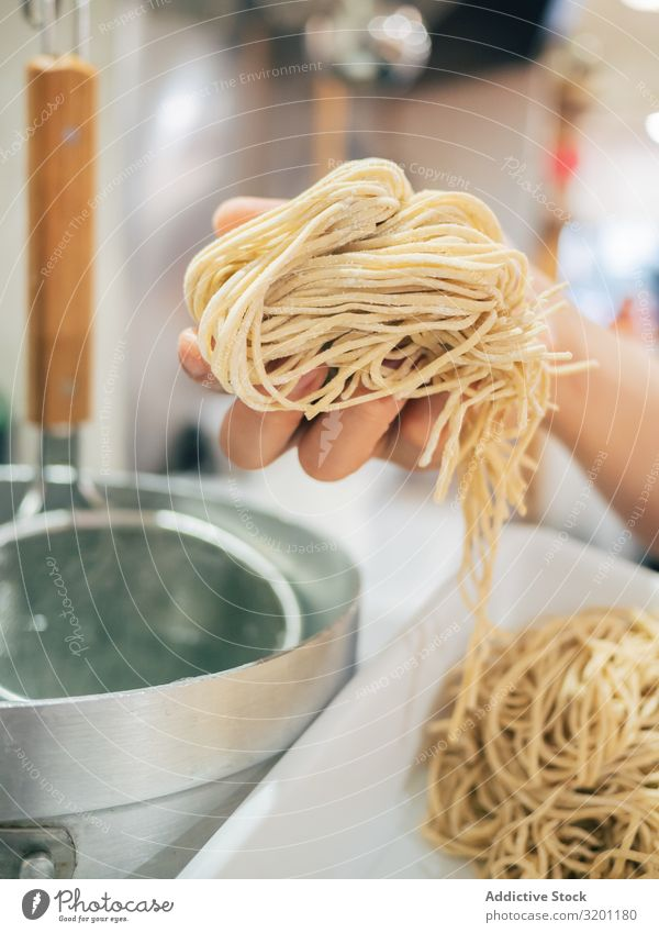 Kitchen staff with noodles for Japanese dish Man Cooking Food Noodles Dish Restaurant