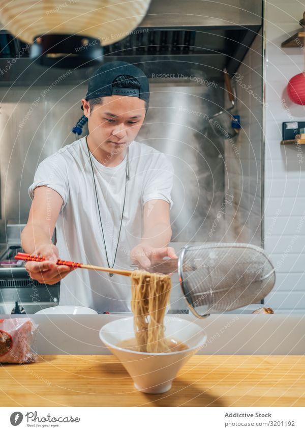 Asian male cooking ramen in cafe Man Cook Food Noodles Japanese Dish Restaurant Café
