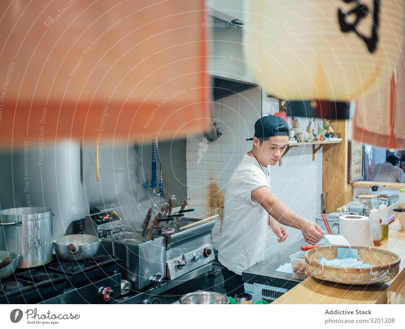 Kitchen staff in Asian cafe Man Cooking Food Japanese Dish Restaurant Work and employment