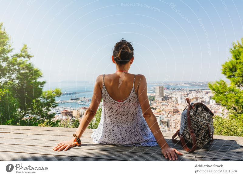 Woman on bench looking at city views from above Skyline City Sightseeing Bench Vacation & Travel Youth (Young adults)