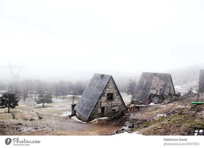 Grungy houses on foggy day House (Residential Structure) Snow Fog Landscape grungy Weather Old Winter Nature Seasons Sky Cold Cool (slang) cottages Weathered