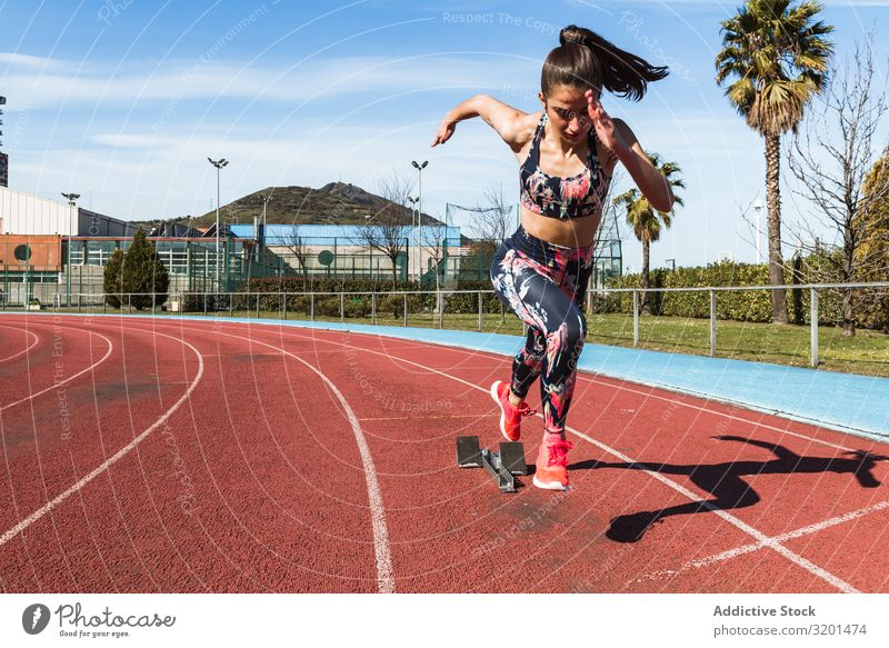 Slim woman running on stadium Woman Running Stadium Track Speed Sports Athlete Sky Sunbeam Day Sportswear Thin Strong Relaxation Fitness sprint Action workout