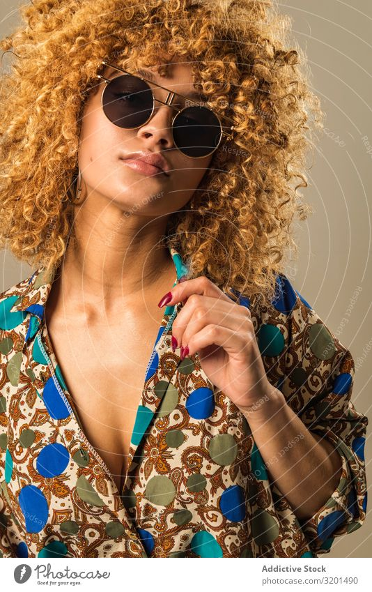 Retro woman with curly hair Woman outfit Ethnic Sunglasses Blouse To enjoy Curly hair Blonde Model Vintage Style Hip & trendy Ornament Pattern Elegant shades