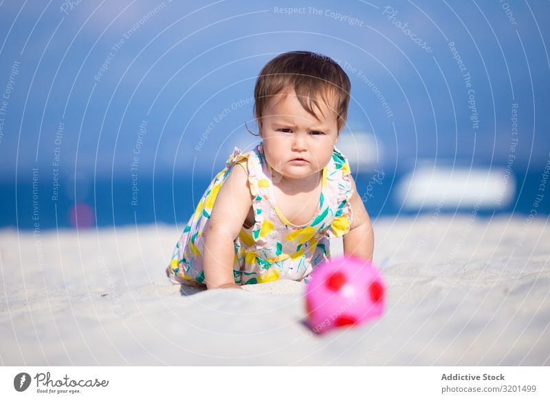 Baby girl playing with ball on beach Ball Beach Sand Summer Child Infancy Girl Toddler Human being Cute Earnest Beautiful concentrated Funny Anger Action Crawl