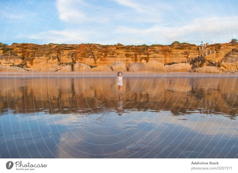 Little girl walking on water of beach seashore Girl Child Ocean Beach Summer Small Human being Curly hair Barefoot Beautiful Action Walking Vacation & Travel