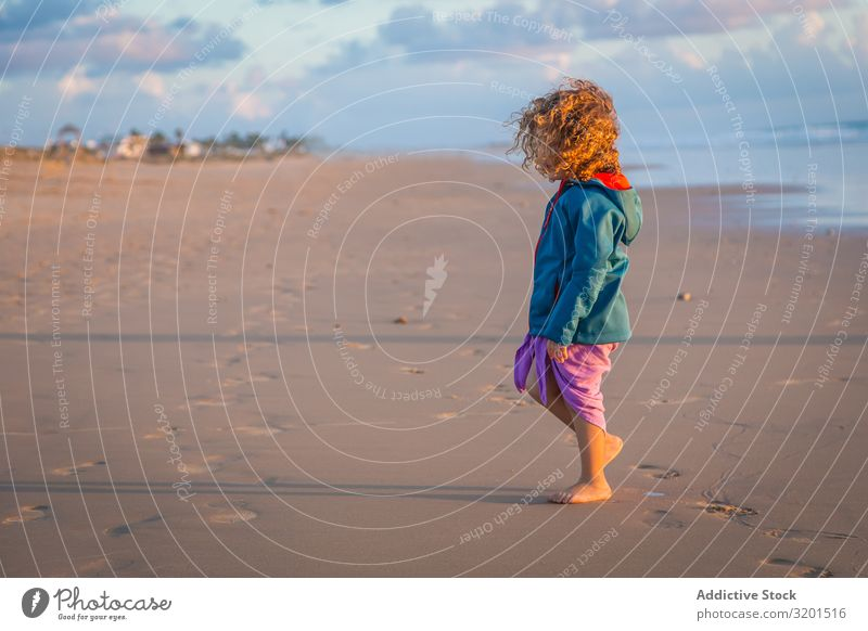 Little girl walking on seashore Girl Child Ocean Beach Summer Small Human being Curly hair Barefoot Beautiful Action Walking Vacation & Travel