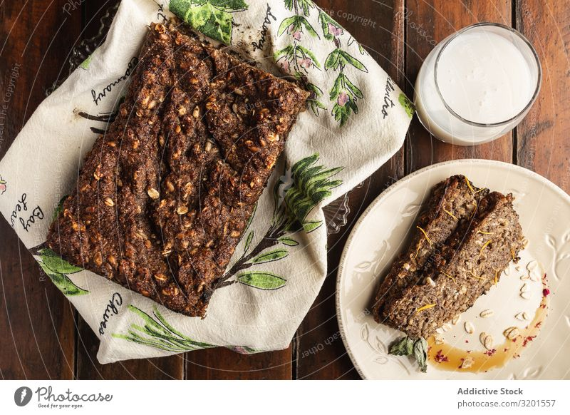 Crispy appetizing cake on plate on wooden surface Cake flakes oat Natural Vegan diet Food Dessert Fresh Delicious Wood Home-made Baking Rustic Bread crispy