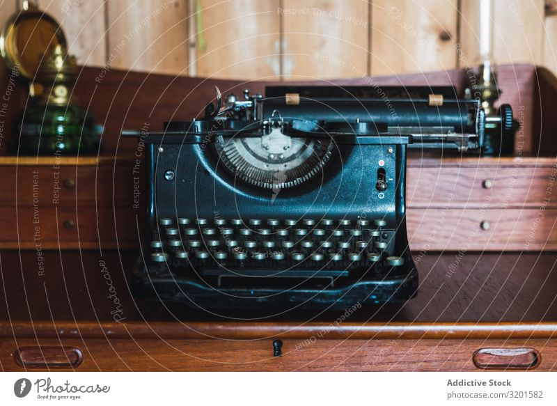 vintage typewriter in a wooden old furniture in a wooden room Typewriter Vintage Old Retro Antique Writer Keyboard machine Communication Object photography